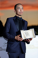 CANNES, FRANCE - JULY 17: Apichatpong Weerasethakul poses with the 'Jury Prize' Ex-Aequo for 'Memoria' during the 74th annual Cannes Film Festival on July 17, 2021 in Cannes, France. (<br /> CAP/GOL<br /> ©GOL/Capital Pictures