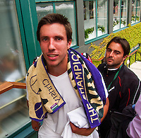 25-06-13, England, London,  AELTC, Wimbledon, Tennis, Wimbledon 2013, Day two, Igor Sijsling (NED) and his coach Joaquin Munoz Berajano after wining the first round<br /> <br /> <br /> <br /> Photo: Henk Koster