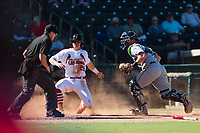 Surprise Saguaros second baseman Andy Young (29), of the St. Louis Cardinals organization, slides safely across home plate in front of the tag of catcher Joe DeCarlo (4) as home plate umpire Brennan Miller looks on during an Arizona Fall League game against the Peoria Javelinas at Surprise Stadium on October 17, 2018 in Surprise, Arizona. (Zachary Lucy/Four Seam Images)