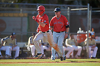 Ball State Cardinals shortstop Ryan Peltier (7) rounds third in front of head coach Rich Maloney (7) during a game against the Mount St. Mary's Mountaineers on March 9, 2019 at North Charlotte Regional Park in Port Charlotte, Florida.  Ball State defeated Mount St. Mary's 12-9.  (Mike Janes/Four Seam Images)