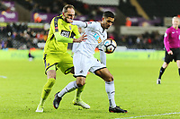 (L-R) Nicky Hunt of Notts County challenges  Kyle Naughton of Swansea City during The Emirates FA Cup match between Swansea City and Notts County at The Liberty Stadium, Swansea, Wales, UK. Tuesday 06 February 2018