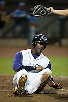 Keon Barnum (20) of the Winston-Salem Dash is called safe at home by home plate umpire Rich Grassa after scoring on a wild pitch in the bottom of the ninth inning against the Myrtle Beach Pelicans at BB&T Ballpark on August 20, 2015 in Winston-Salem, North Carolina.  The Dash defeated the Pelicans 5-4 on a walk-off wild pitch in the bottom of the 9th inning.  (Brian Westerholt/Four Seam Images)