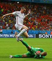 Fernando Torres of Spain hurdles over Netherlands goalkeeper Jasper Cillessen