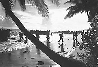 American troops of the 160th Infantry Regiment rush ashore from a landing boat during amphibious training here.  Guadalcanal, March 1, 1944.  Preston.  (Army)<br /> NARA FILE #:  111-SC-192796<br /> WAR & CONFLICT BOOK #:  1172