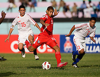 Roberto Chen (5) of Panama takes a shot during the group stage of the CONCACAF Men's Under 17 Championship at Jarrett Park in Montego Bay, Jamaica. Panama tied Cuba, 0-0.