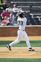 Nick Bisplinghoff (39) of the Wake Forest Demon Deacons follows through on his swing against the Miami Hurricanes at Wake Forest Baseball Park on March 21, 2015 in Winston-Salem, North Carolina.  The Hurricanes defeated the Demon Deacons 12-7.  (Brian Westerholt/Four Seam Images)