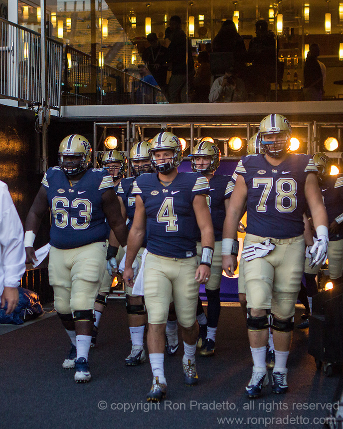 Pitt takes the field led by Alex Officer (63), Nathan Peterman (4), and Alex Bookser (78). The Pitt Panthers defeated the Marshall Thundering Herd 43-27 on October 1, 2016 at Heinz Field in Pittsburgh, Pennsylvania.