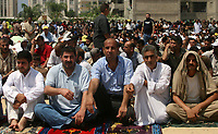 "Palestinian Fatah supporters attend Friday prayers in Gaza August.31.2007""photo by Fady Adwan"""