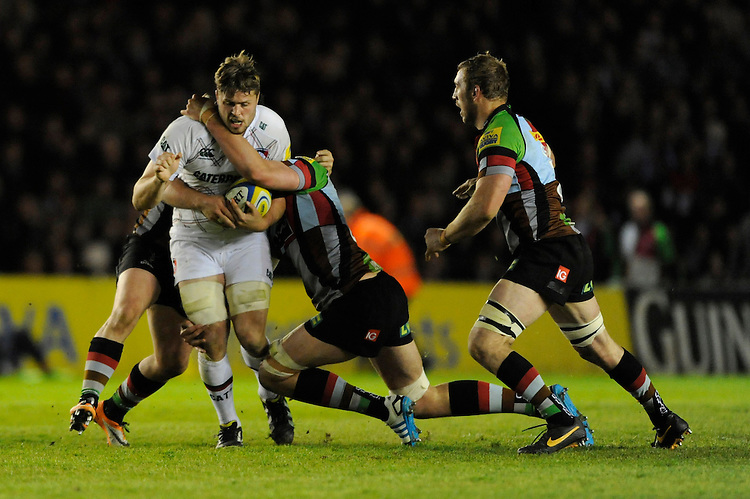 Ed Slater of Leicester Tigers is tackled during the Aviva Premiership match between Harlequins and Leicester Tigers at the Twickenham Stoop on Friday 18th April 2014 (Photo by Rob Munro)