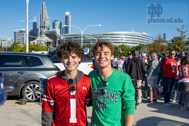 September 25, 2021; University of Wisconsin student Jacob Cassella and his twin brother Joseph, ND '24 pose for a photo outside Soldier Field before the 2021 Shamrock Series game between Notre Dame and Wisconsin. (photo by Matt Cashore/University of Notre Dame)