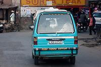 "Kathmandu, Nepal.  Bumber Sticker on Kathmandu Street.  ""Keep Yours Distant."""