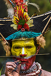 Huli Wigmen (chief Timon Tumbu) in traditional / ceremonial dress with plumes of Birds of Paradise, dwarf cassowary, parrots and lorikeets. Tari Valley, Papua New Guinea.