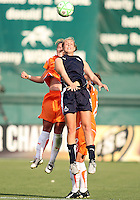 Allie Long #9 of Washington Freedom goes up for a header with Jen Buczkowski #4 of Sky Blue FC during a WPS match at RFK Stadium on May 23, 2009 in Washington D.C. Freedom won the match 2-1