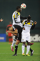Washington D.C. - March 8, 2014: Tony Tchani (6) of the Columbus Crew heads the ball against Luis Silva (11) of D.C. United.  The Columbus Crew defeated D.C. United 3-0 during the opening game of the 2014 season at RFK Stadium.