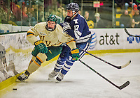4 January 2014:  University of Vermont Catamount Defenseman Michael Paliotta, a Junior from Westport, CT, in first period action against the Yale University Bulldogs at Gutterson Fieldhouse in Burlington, Vermont. With an empty net and seconds remaining, the Cats came back to tie the game 3-3 against the 10th seeded Bulldogs. Mandatory Credit: Ed Wolfstein Photo *** RAW (NEF) Image File Available ***