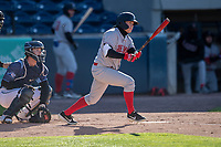 Great Lakes Loons left fielder Ryan Ward (15) follows through on his swing against the West Michigan Whitecaps at LMCU Ballpark on May 11, 2021 in Comstock Park, Michigan. (Andrew Woolley/Four Seam Images)