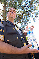 The chauffeur driver drinks water - a brilliant bottle of mineral water - Château Pey la Tour, previously Clos de la Tour or de Latour, Bordeaux, France
