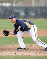 Chris Narveson #38 of the Milwaukee Brewers participates in pitchers fielding practice during spring training workouts at the Brewers complex on February 18, 2011  in Phoenix, Arizona. .Photo by Bill Mitchell / Four Seam Images.