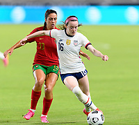 HOUSTON, TX - JUNE 10: Rose Lavelle #16 of the United States brings the ball up the field in front of Fatima Pinto #13 of Portugal during a game between Portugal and USWNT at BBVA Stadium on June 10, 2021 in Houston, Texas.