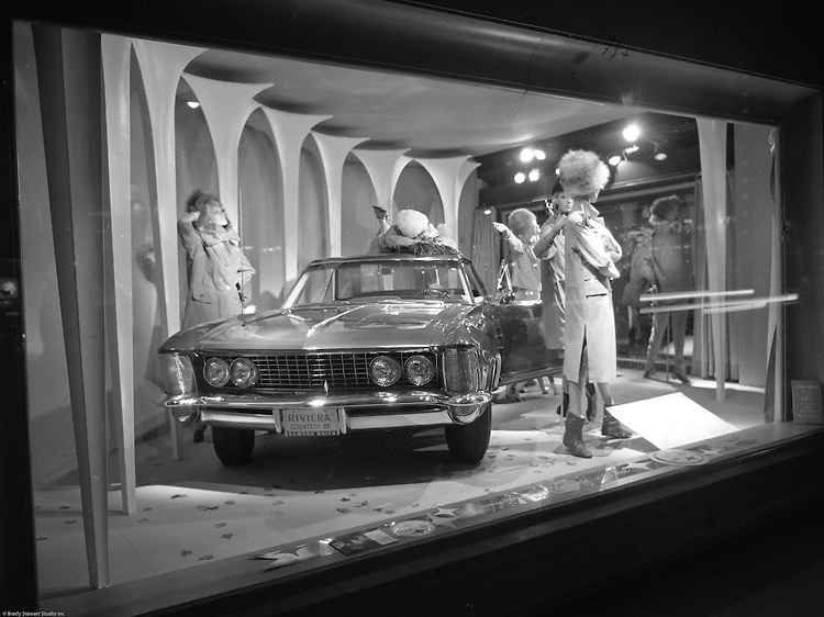 Client: US Steel<br /> Ad Agency: US Steel Marketing<br /> Contact:<br /> Product: Steel displays and fixtures and consumer products made from steel.<br /> Location: Hornes Department Store in downtown Pittsburgh<br /> <br /> View of Christmas window display at Horne's department store in Pittsburgh. New Buick Riviera on display during the Rhapsody of Steel campaign.  US Steel launched an awareness campaign of all the current uses of steel in everyday products.  During this time, ALCOA Aluminum Company of America also headquartered in Pittsburgh, was aggressively competing to enter markets where US  steel companies traditionally dominated market share. Examples included beer and food Cans, appliances, automobile parts, children's toys/bicycles, and more.