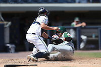 West Michigan Michigan Whitecaps catcher Drew Longley (14) tags Fort Wayne TinCaps baserunner Hudson Potts (20) at the plate during the Midwest League baseball game on April 26, 2017 at Fifth Third Ballpark in Comstock Park, Michigan. West Michigan defeated Fort Wayne 8-2. (Andrew Woolley/Four Seam Images)