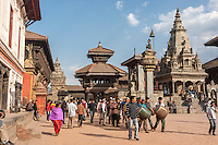 Bhaktapur, Nepal.  Durbar Square, Palace of 55 Windows on Left, Vatsala Durga Temple on right.  The temple was completely destroyed in the earthquake of April 2015.  King Bhupatindra's Column remained standing.