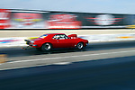 Drag Racing. Red Camero races to victory.