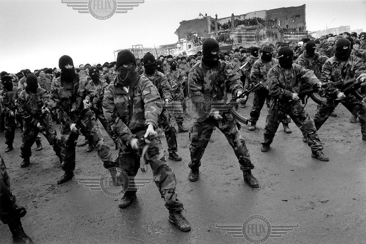 © Heidi Bradner / Panos Pictures..Grozny, Chechnya. 1998...Chechen special forces prepare for the second Russian war during the anniversary of the Chechen deportation in 1944, when Stalin deported all Chechens to Kazakhstan.