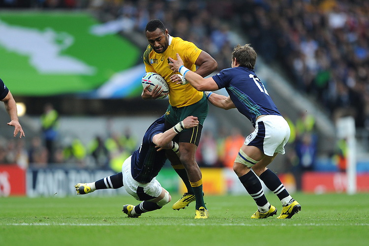 Tevita Kuridrani of Australia is tackled by Finn Russell and Peter Horne of Scotland during the Quarter Final of the Rugby World Cup 2015 between Australia and Scotland - 18/10/2015 - Twickenham Stadium, London<br />