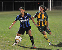 20130906 - VARSENARE , BELGIUM : Brugge's Jody Vangheluwe (left) pictured protecting the ball for ADO's Renate Jansen (right) during the female soccer match between Club Brugge Vrouwen and ADO DEN HAAG Dames , of the third matchday in the BENELEAGUE competition. Friday 06 th September 2013. PHOTO JOKE VUYLSTEKE