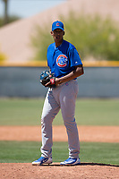 Chicago Cubs relief pitcher Yovanny Cruz (50) prepares to deliver a pitch during an Extended Spring Training game against the Colorado Rockies at Sloan Park on April 17, 2018 in Mesa, Arizona. (Zachary Lucy/Four Seam Images)
