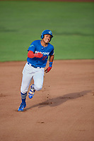 Romer Cuadrado (17) of the Ogden Raptors hustles to third base against the Idaho Falls Chukars at Lindquist Field on August 28, 2017 in Ogden, Utah. Ogden defeated Idaho Falls 7-1. (Stephen Smith/Four Seam Images)