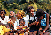 Libreville, Gabon. Group of laughing girls and women of different ages.