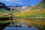 Alpine lake in the American Basin (12,300 feet) below Cinnamon Pass, San Juan Mountains, southwest Colorado, USA .  John leads wildflower photo tours into American Basin and throughout Colorado. All-year long. John guides custom photo tours in the Sneffels Range and throughout Colorado. .  John leads private photo tours throughout Colorado. Year-round Colorado photo tours.