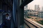 "A passenger in the ""hard-sleeper"" section of the train passing through the city of Shenzhen, China."