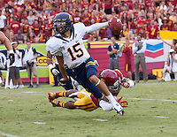 September 22, 2012: California's Zach Maynard scrambles away from USC defender during a game at the Los Angeles Memorial Coliseum, Los Angeles, Ca  USC defeated California 27- 9