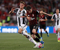 Calcio, finale Tim Cup: Milan vs Juventus. Roma, stadio Olimpico, 21 maggio 2016.<br /> AC Milan's Andrea Poli, right, is challenged by  Juventus' Daniele Rugani during the Italian Cup final football match between AC Milan and Juventus at Rome's Olympic stadium, 21 May 2016.<br /> UPDATE IMAGES PRESS/Isabella Bonotto