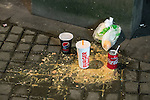 """© Joel Goodman - 07973 332324 . 17/12/2016 . Manchester , UK . The remnants of a takeaway and vomit on the pavement , in Piccadilly Gardens . Revellers out in Manchester City Centre overnight during """" Mad Friday """" , named for being one of the busiest nights of the year for the emergency services in the UK . Photo credit : Joel Goodman"""