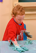 MR/Schenectady, New York.Schenectady Day Nursery: private, non-profit daycare Toddler class .Girl (30 months) cleans up after art project using shaving cream and food coloring..MR:Rob5       FC#:27912-00119.© Ellen B. Senisi