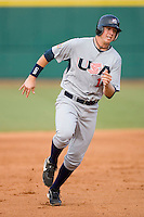 Justin Smoak #16 of Team USA hustles towards third base versus Team Canada at the USA Baseball National Training Center, September 4, 2009 in Cary, North Carolina.  (Photo by Brian Westerholt / Four Seam Images)