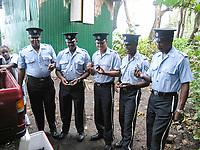 local police help to release leatherback sea turtle hatchlings, Dermochelys coriacea, Dominica, Caribbean, Atlantic