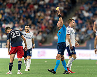 FOXBOROUGH, MA - AUGUST 18: Ted Unkel gives Arnor Traustason #25 of New England Revolution second yellow card and ejection during a game between D.C. United and New England Revolution at Gillette Stadium on August 18, 2021 in Foxborough, Massachusetts.