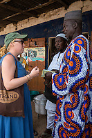 Peace Corps Volunteer Talking to Farmer Selling Cashew Nuts,  Fass Njaga Choi, The Gambia