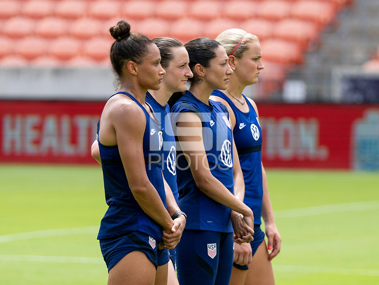 HOUSTON, TX - JUNE 9: Lynn Williams #6, Andi Sullivan #25, Christen Press #23 and Lindsey Horan #9 of the USWNT watch a drill during a training session at BBVA Stadium on June 9, 2021 in Houston, Texas.