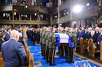 The casket of former Quebec premier Bernard Landry is carried into Notre-Dame Basilica  in Montreal on Tuesday, November 13, 2018. THE CANADIAN PRESS/Paul Chiasson