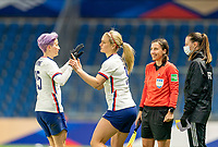 LE HAVRE, FRANCE - APRIL 13: Megan Rapinoe #15 of the USWNT shakes hands with Lindsey Horan #9 as she enters the game during a game between France and USWNT at Stade Oceane on April 13, 2021 in Le Havre, France.