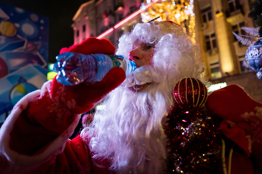 31/12/2019, Moscow, Russia.<br /> A man dressed as Ded Moroz [Father Frost] pulls his beard aside to drink from a water bottle as revellers celebrate Russian New Year in central Moscow.