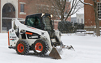 Snow continues to fall Monday, February 15, 2021, as Marshall Wood, with the city of Fayetteville Parks and Recreation, clears snow from the streets in downtown Fayetteville. The National Weather Service is forecasting several inches of snow throughout the state through Wednesday and Thursday. Check out nwaonline.com/210216Daily/ and nwadg.com/photos for a photo gallery.<br /> (NWA Democrat-Gazette/David Gottschalk)