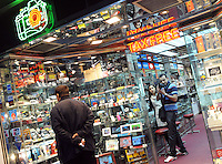 Tourists test out the digital camera in a Tax Free electronic shop in Hong Kong. Hong Kong is well-known as the tax-free shopping paradise for its competitive prices, varieties of goods and its great customer service..