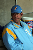 Myrtle Beach Pelicans hitting coach Julio Garcia #33 in the dugout before a game against the Frederick Keys at Tickerreturn.com Field at Pelicans Ballpark on April 25, 2012 in Myrtle Beach, South Carolina. Myrtle Beach defeated Frederick by the score of 3-1. (Robert Gurganus/Four Seam Images)
